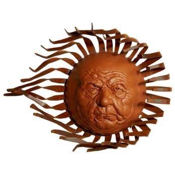 Large Sol Sun Face on Windblown Metal Ray