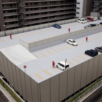 Parking deck waterproofing with wear-resistant top coat